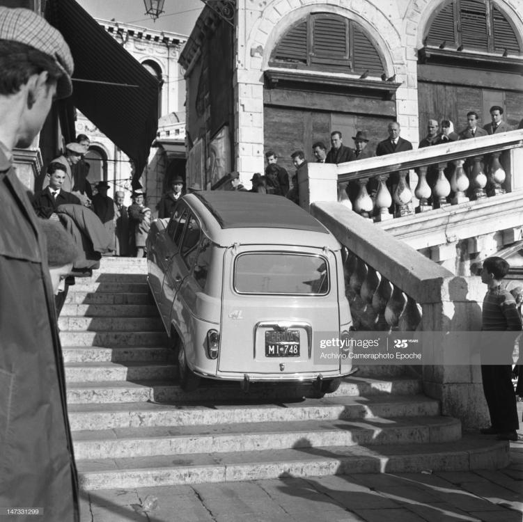 renault-4l-car-getting-up-the-stairs-of-