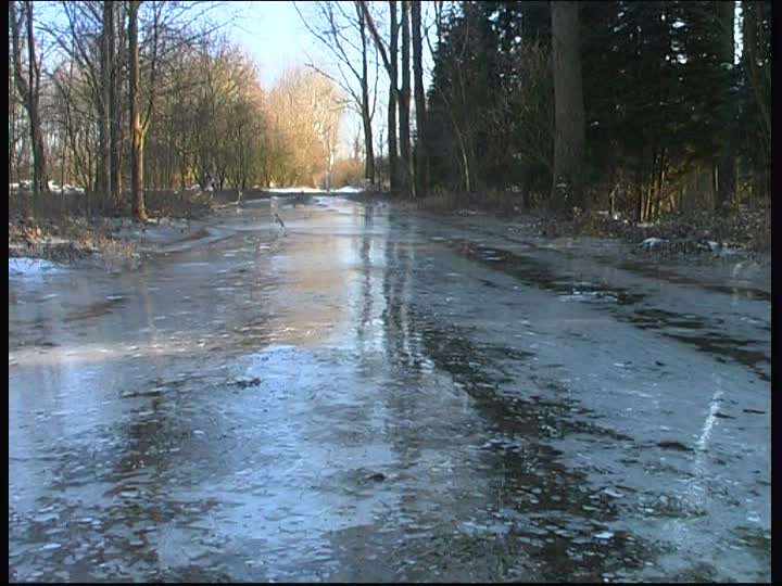 218710571-glazed-frost-ice-surface-country-road-frozen-icy.jpg