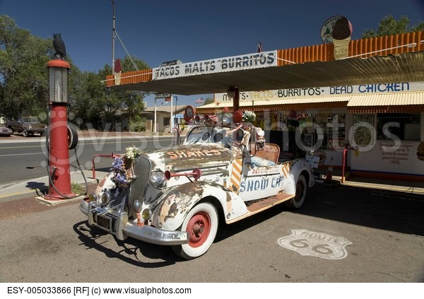 old-gas-pump-and-decorated-vintage-car-parked-in-front-of-burger-joint-in-seligman-arizona-off-route-66.jpg